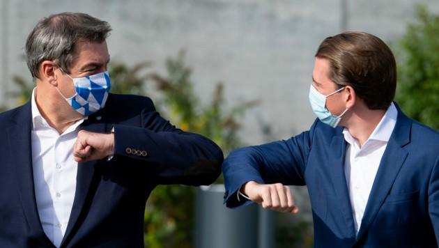 Kanzler Sebastian Kurz mit dem bayrischen Ministerpräsidenten Markus Söder (Bild: (c) dpa-Pool)