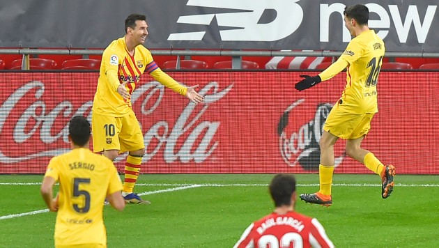 Messi (li.) und Pedri (Bild: AFP )