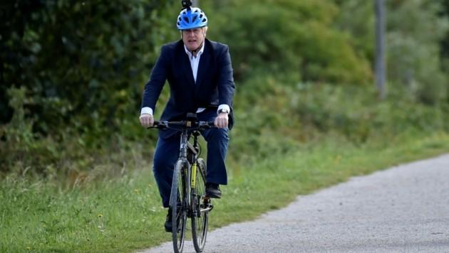 Der britische Premierminister Boris Johnson fährt gerne mit dem Fahrrad, wie hier im Sommer 2020.