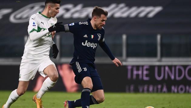 Mert Müldür (li.) im Duell mit Juventus-Kicker Aaron Ramsey (Bild: AFP )