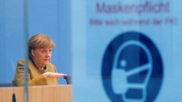Die Deutsche Kanzlerin machte aber auch Hoffnungen für den Frühling. (Bild: AFP/FABRIZIO BENSCH)