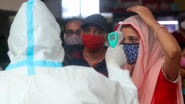 Die Infektionszahlen im bevölkerungsreichsten Staat der Erde steigen rasant an. (Bild: AP)