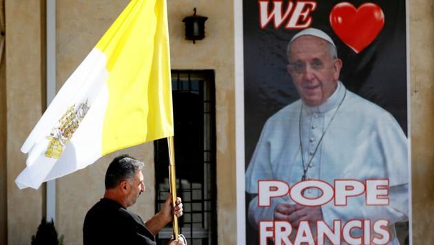 Eine kleine christliche Minderheit verehrt den Papst auch im Irak. (Bild: AP/Photo/Hadi Mizban)