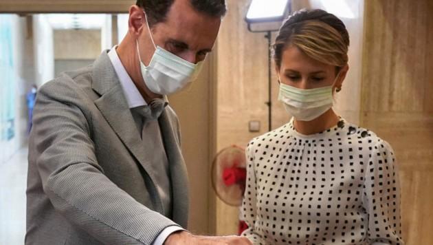 Bashar al-Assad mit Gattin Asma (Bild: AFPSyrian Presidency Facebook page / AFP)