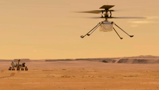 """Künstlerische Illustration: So könnte der Hubschrauber """"Ingenuity"""" über die Oberfläche des Roten Planeten fliegen. (Bild: NASA/JPL-Caltech)"""