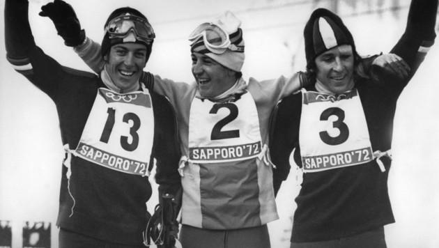 Roland Thöni (rechts) zusammen mit Francisco Fernandez Ochoa (Mitte) und Gustav Thöni (Bild: APA/AFP/GEORGES BENDRIHEM)