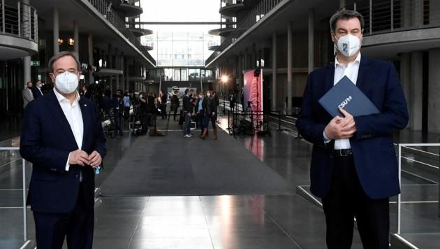 Armin Laschet (li., CDU) und Markus Söder (CSU) (Bild: AFP)