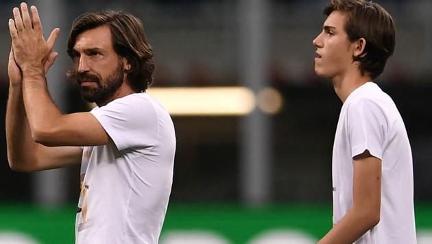 Andrea Pirlo und sein Sohn, Niccolo. (Bild: AFP/Marco Bertorello)