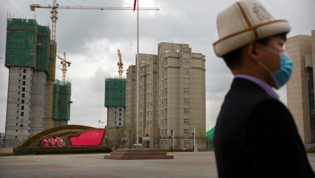 China warnt die UN-Staaten vor einer Veranstaltung über den Umgang Pekings mit der Volksgruppe der Uiguren. (Bild: AP)