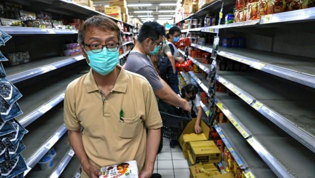 Taiwan verschärft die Maßnahmen, es kam zu Hamsterkäufen. (Bild: REUTERS)