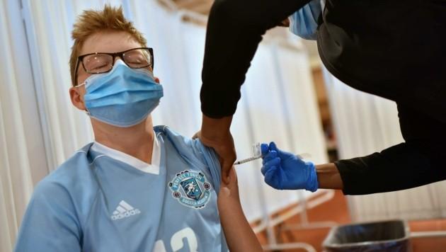 Es ist unklar, wie viele Jugendliche sich impfen lassen werden (Bild: ANTHONY BEHAR/SIPA USA)