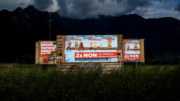 Neben dem CO2-Gesetz sind auch beide Umweltschutzinitiativen abgelehnt worden. (Bild: APA/AFP/Fabrice COFFRINI)