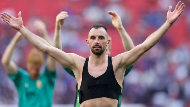 Als wollte er die ganze Welt umarmen, Ungarns Attila Fiola nach dem 1:1 gegen Frankreich. (Bild: AP/Alex Painting)
