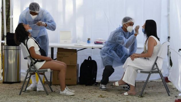 Zwei Studien aus China und Kanada untermauern die Gefahr, die von der Delta-Variante des Coronavirus ausgeht. (Bild: AFP)