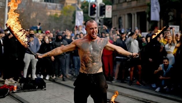 In der australischen Metropole Sydney ist es bei Protesten gegen den Corona-Lockdown zu Zusammenstößen mit der Polizei gekommen. (Bild: AFP)