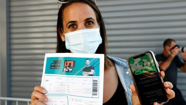 Wegen steigender Corona-Infektionszahlen gilt in Israel seit Donnerstag wieder der Grüne Pass, der in Israel zunächst im Februar eingeführt worden war. (Bild: AFP)