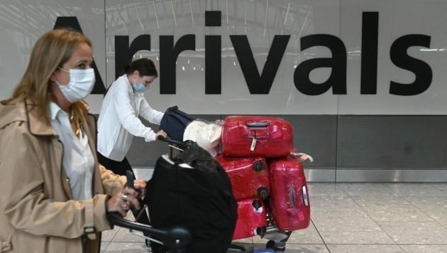 England hebt für Einreisende aus fast allen EU-Staaten sowie aus den USA die Quarantänepflicht auf. (Bild: AFP/Daniel Leal-Olivas)