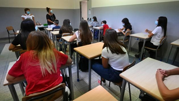 Wenn Lehrkräfte in Italien künftig keinen Nachweis vorlegen, werden sie nach fünf Tagen vom Dienst suspendiert. (Bild: AFP)