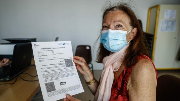 In Frankreich haben strengere Corona-Regeln und das angekündigte Ende kostenloser Tests die Impfquote weiter steigen lassen. (Bild: AFP/Sameer Al-Doumy)