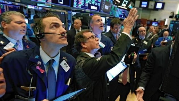 Der Klimawandel macht auch vor der mächtigen Finanzbranche nicht halt. (Bild: AP Photo/Richard Drew)