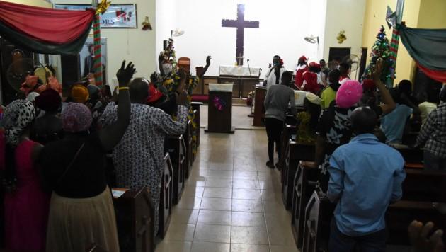 Ein Gottesdienst in Nigeria (Bild: PIUS UTOMI EKPEI / AFP)