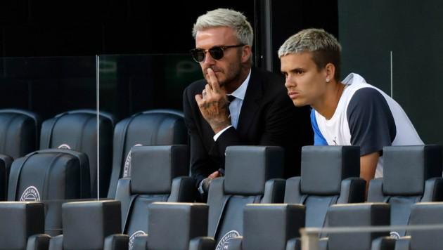 David Beckham mit Sohn Romeo (Bild: AP)