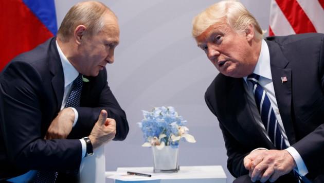 Putin mit Trump am G20-Gipfel (Bild: AP)
