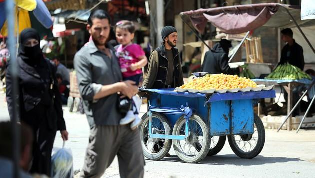Straßenszene aus Damaskus vom 23.5.2017 - seit 2011 herrscht in Syrien Bürgerkrieg. (Bild: AFP)