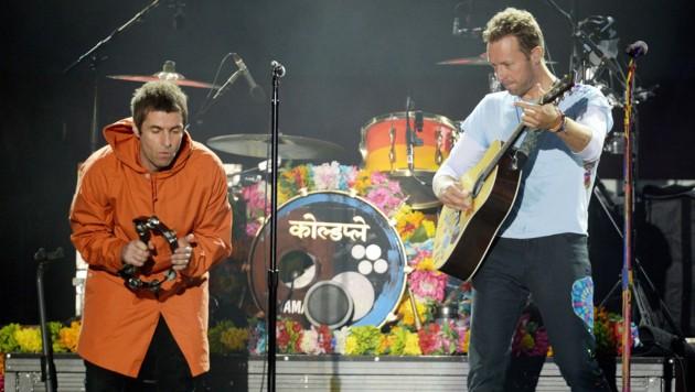 Liam Gallagher (Oasis, li.) und Christ Martin (Coldplay) (Bild: AP)