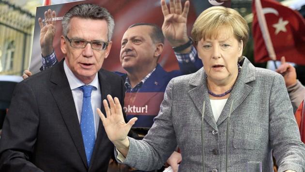 Innenminister de Maiziere, Kanzlerin Merkel (Bild: AP, APA/EPA/WOLFGANG KUMM)