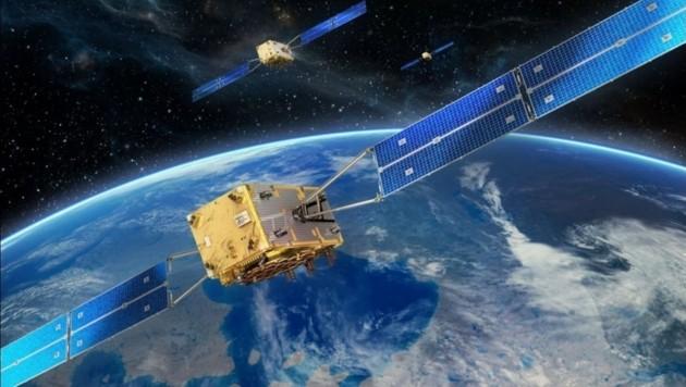"""Künstlerische Illustration: """"Galileo""""-Satelliten im Erdorbit (Bild: ESA/OHG)"""