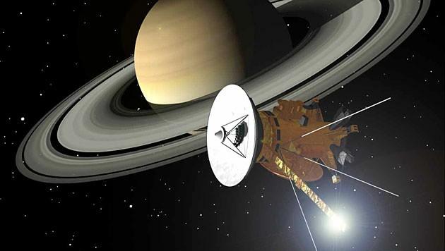 """Illustration: Die Sonde """"Cassini"""" vor dem Ringplaneten Saturn"""