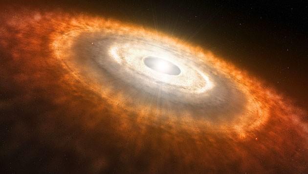 Künstlerische Darstellung einer Gas- und Staubscheibe um einen jungen Stern