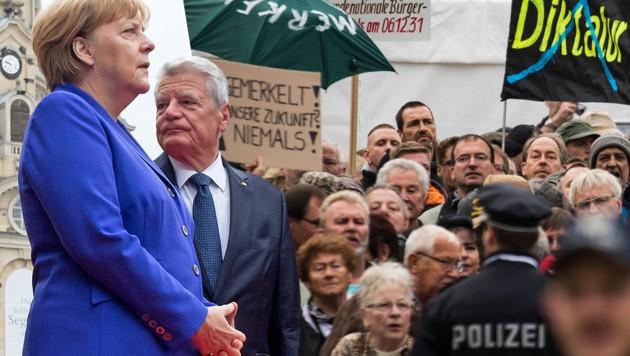 (Bild: AFP/ODD ANDERSEN, AP/Jens Meyer)