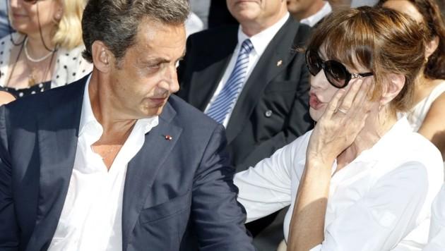 Nicolas Sarkozy und seine Frau Carla Bruni