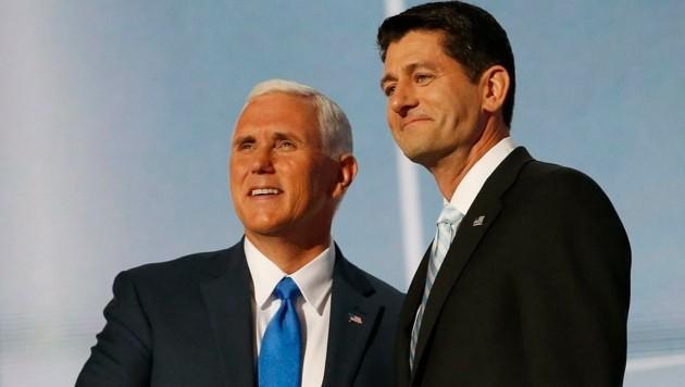 Vizepräsidentschaftskandidat Mike Pence (li.) stellt sich hinter Trump-Kritiker Paul Ryan.
