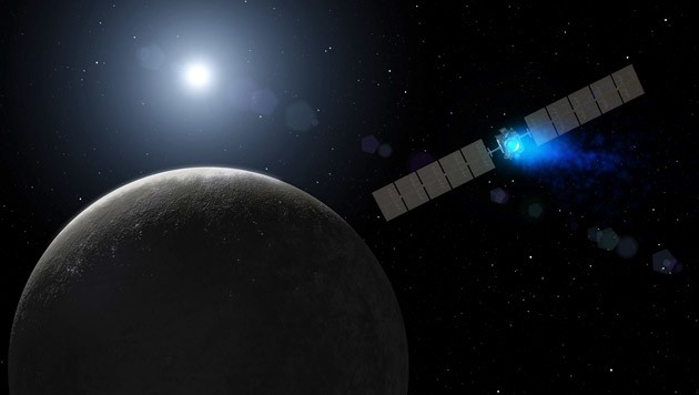 """Illustration: Die Raumsonde """"Dawn"""" im Orbit von Ceres (Bild: NASA/JPL-Caltech)"""