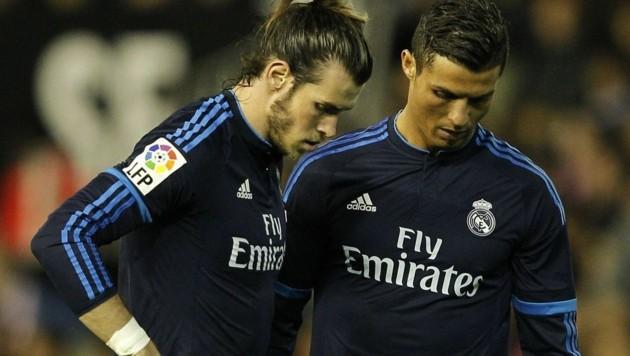 Ob Gareth Bale und Cristiano Ronaldo gerade ein Loch suchen, in das sie sich verkriechen könnten?