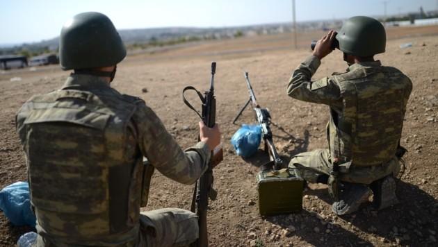 Türkische Soldaten im Einsatz (Bild: APA/AFP/Bulent Kilic)