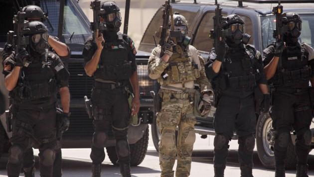 Spezialkräfte aus dem Irak, Jordanien und den USA bei einer gemeinsamen Übung in Amman. (Bild: AP)