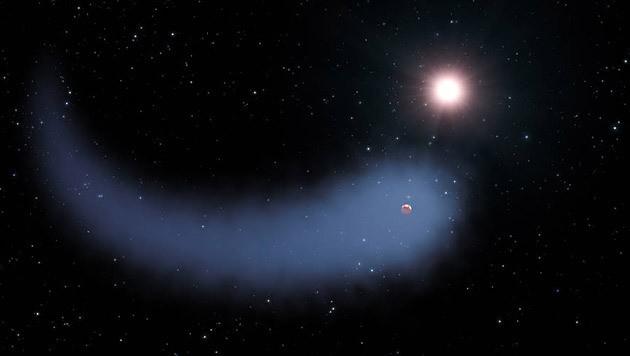 Der Exoplanet GJ 436b und sein gewaltiger Wasserdampf-Schweif (Bild: NASA, ESA und G. Bacon (STScI))