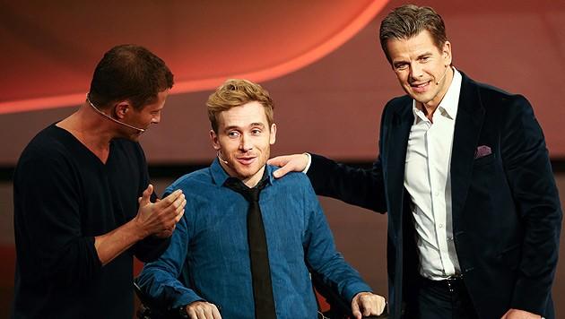 Markus Lanz mit Samuel Koch und Til Schweiger (Bild: APA/EPA/DAVID EBENER)