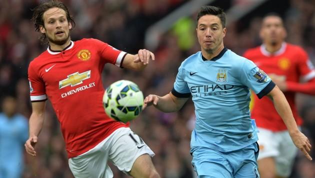 Die Manchester-Stars Blind (United, li.) und Nasri (City) bekommen eine Reihe teurer Mitspieler. (Bild: APA/EPA/PETER POWELL)