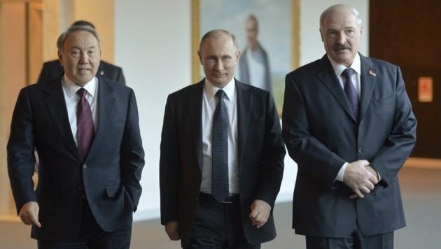 Der kasachische Staatschef Nasarbajew, Kremlchef Putin und Weißrusslands Präsident Lukaschenko