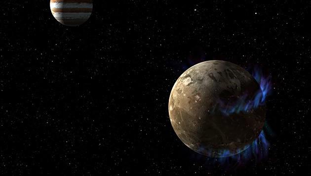 Künstlerische Darstellung von Ganymed samt Polarlichtern