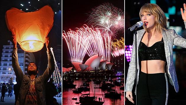 Im Libanon ließ man Laternen steigen, Riesenfeuerwerk in Sydney und Taylor Swift am Times Square. (Bild: AP, APA/EPA/JASON SZENES)