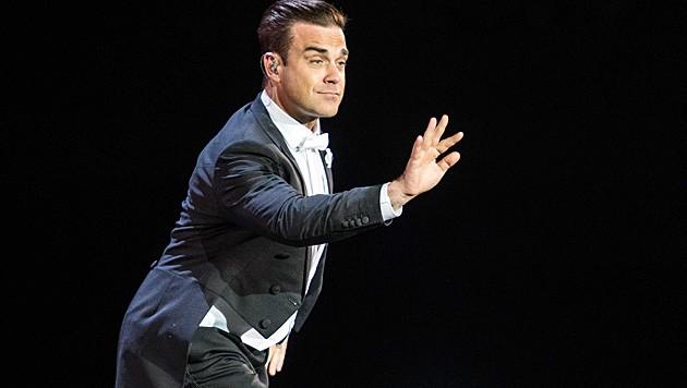 """Robbie Williams plaudert während eines Konzertes aus: """"Es wird ein Bub!"""" (Bild: APA/EPA/FERDY DAMMAN)"""