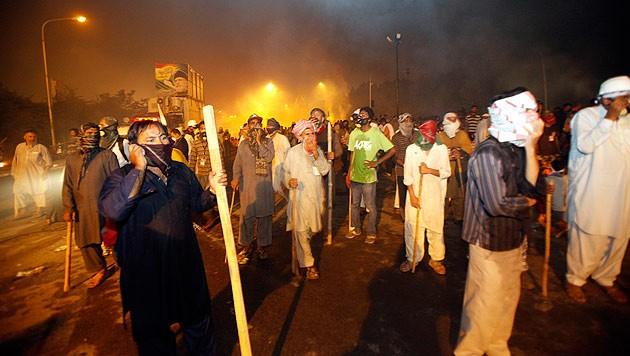 Proteste gegen die Regierung Pakistans in Islamabad (Bild: AP)