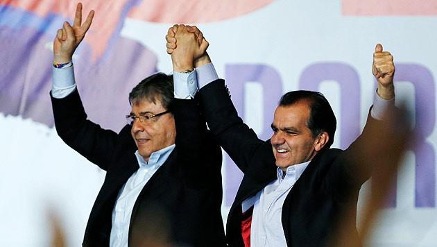 Juan Manuel Santos (li.) und Oscar Ivan Zuluaga (re.) müssen sich der Stichwahl stellen. (Bild: AP)