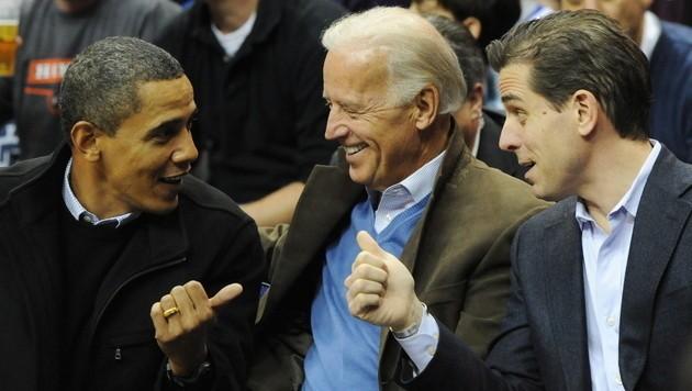 US-Präsident Obama zusammen mit seinem Vize Joe Biden und dessen Sohn Hunter bei einem Sportevent. (Bild: ALEXIS C. GLENN/EPA/picturedesk.com)